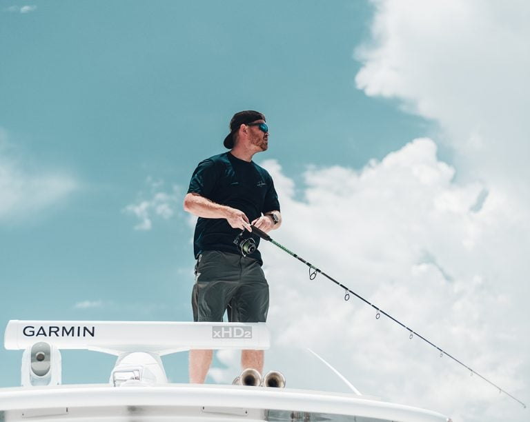 Custom Rod and Reel Angler Fishing On Roof Of Boat